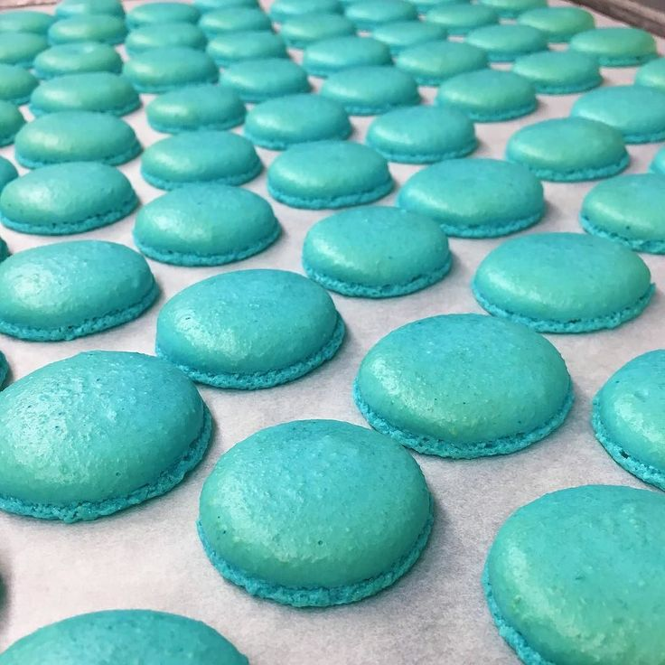 Rows and rows of macaron cookies coming out for the oven at our Andover bakery! Order macarons in custom colors and flavors for a wedding or event! #cafepierrotbts