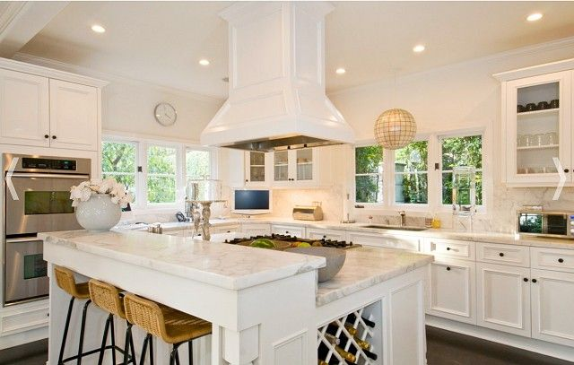 raised eating bar, hood-fan center of attention, wine rack, double oven