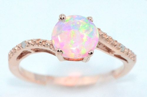 Love the idea of this for a promise ring. 14Kt Rose Gold Plated Pink Opal Round DIamond Ring on Etsy, $39.99