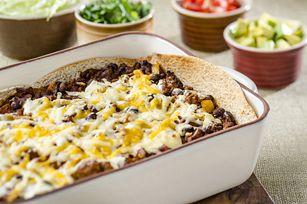Cette casserole d'enchiladas connaît un tel succès que nous avons décidé de l'améliorer encore! Essayez cette nouvelle recette qui compte désormais moins de calories, de sel et de matières grasses.