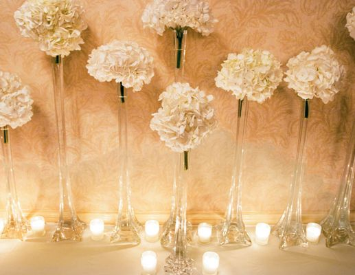 Play with heights of flowers and candles; tea candles around tall vases with flowers. Also a great way to show off bouquets.