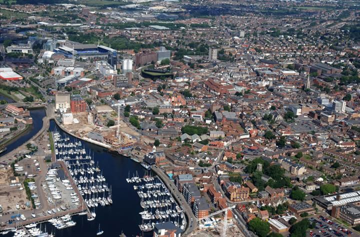 #Ipswich is a large town in Suffolk, England, of which it is the county town. Ipswich is located on the estuary of the River Orwell. Nearby towns are Felixstowe, Woodbridge, Needham Market and Stowmarket in Suffolk and Harwich and Colchester in Essex. Ipswich is a non-metropolitan district.