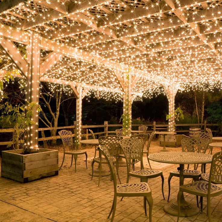 Hang white icicle lights to create magical outdoor Patio and deck lighting ideas