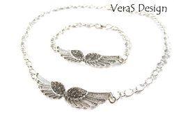 Halsband och armband med vingar - Silverfärg