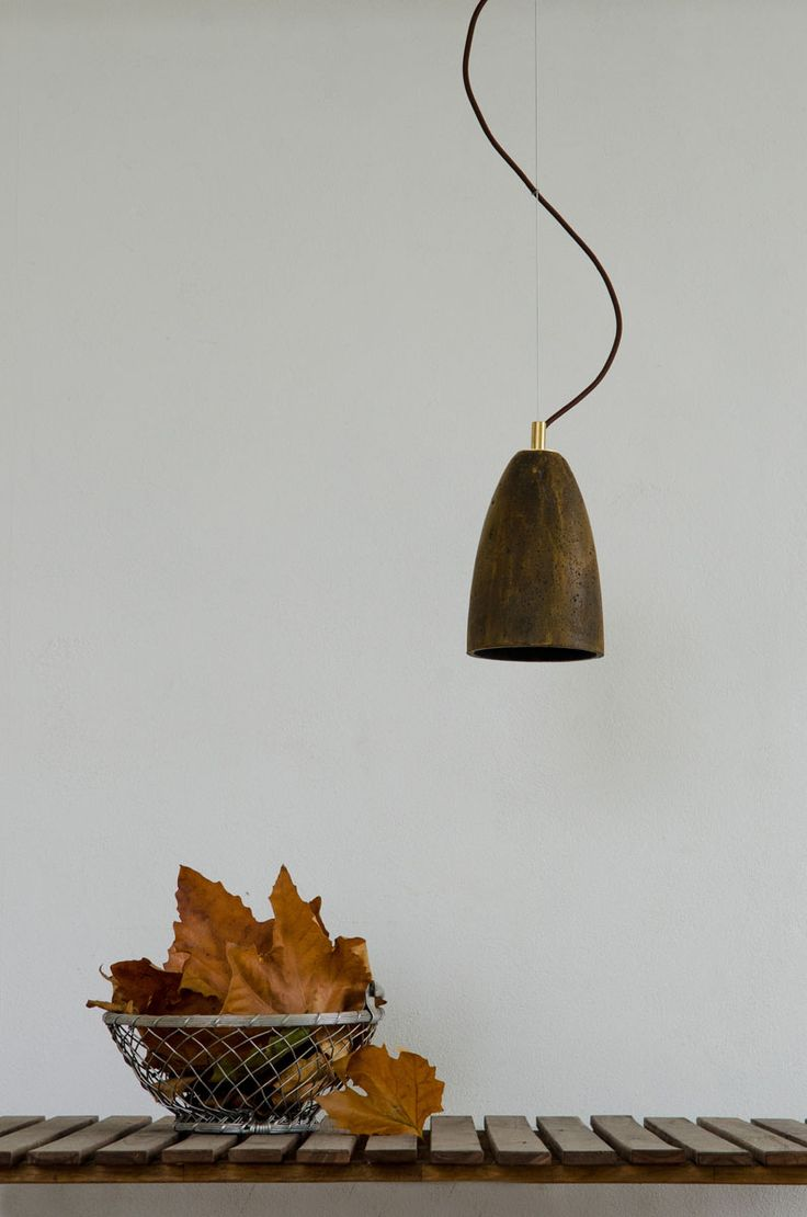 Rusty grey is our new decorative finish for concrete lamps. Here applied on FEBE S pendant lamp - with brass elements.