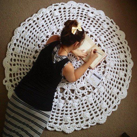 Beautiful doily rug using zpagetti yarn and a 12mm hook; based on this pattern available on Ravelry: http://www.ravelry.com/patterns/library/doily-21st-century-mystery-cal