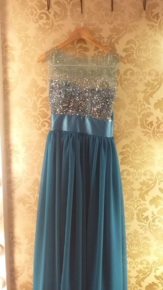 Blue Dress with sequinned detail on the top and satin flowy bottom.