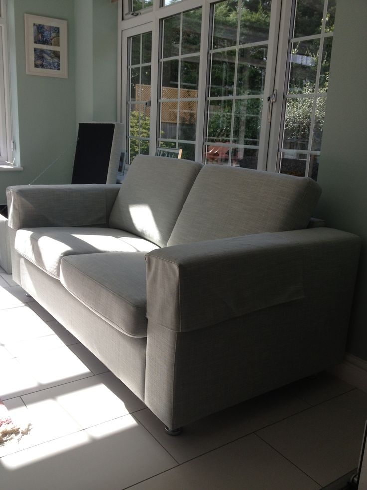 Helpful side view of this small and compact laburnum sofa in a sunny garden  room.