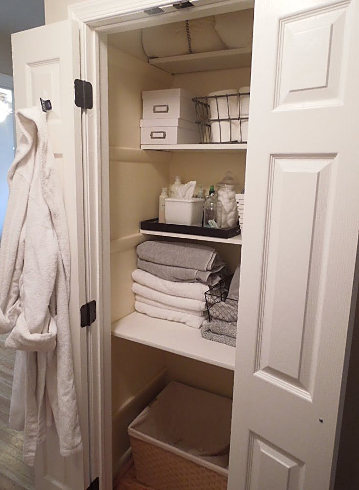 deep closet; hamper on bottom; full shelf above hamper; half shelves above
