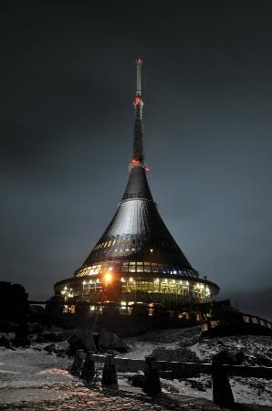 Hotel Ještěd, Czech Republic   The tower was designed to naturally extend the silhouette of the mountain it tops, but isn't merely decorative. It is a television transmitter, built to withstand the extreme climate.