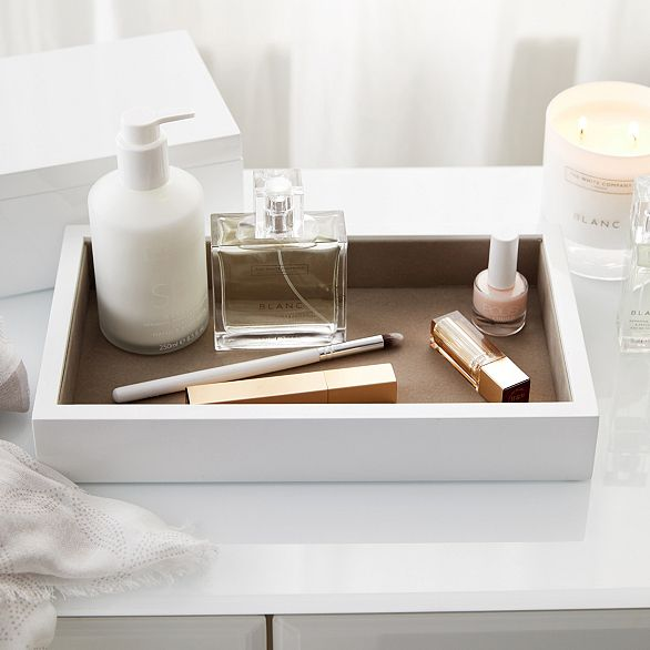 Beautifully simple and wonderfully practical, this sleek, white lacquer jewellery tray is designed to perfectly hold your larger pieces of jewellery. Lined with a lovely soft-grey felt, it looks sleek on any side table and can even be used within your dressing-table drawers. What makes this tray so special is that it can be stacked beneath our matching White Lacquer Jewellery Box for extra storage. Finished with a slatted base, this tray will sit seamlessly upon as many trays as you require…