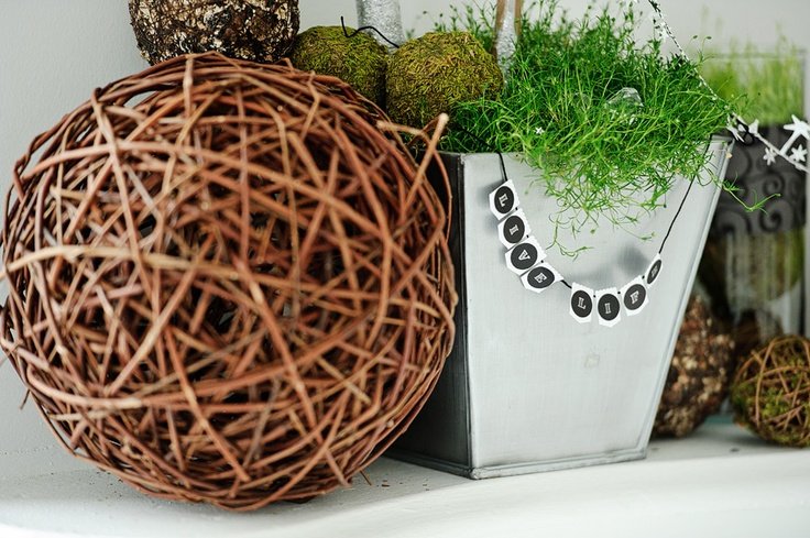 Wicker balls on fireplace mantle