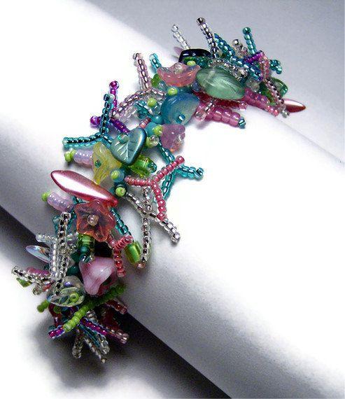 "Beaded Bracelet Beadweaving Handmade Seed Beads Glass Flowers Leaf Beads Tropical Fringe Art Jewelry 8 1/4"". $60.00, via Etsy."