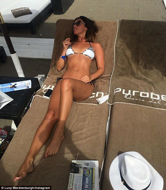 Sunkissed: Lucy Mecklenburgh, 25, topped up her already enviable tan on Tuesday as she sunbathed on the beach in Marbella, Spain