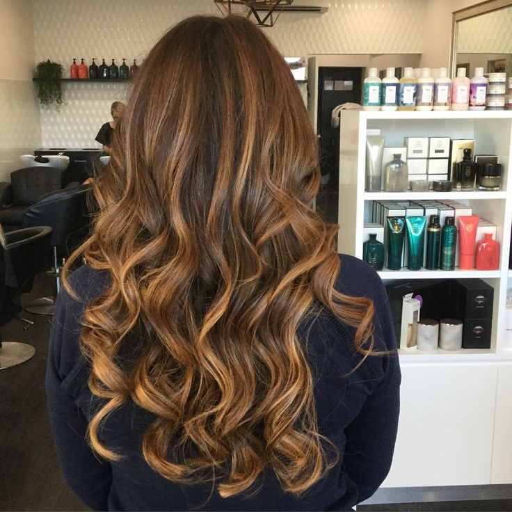 Warm brunette hair colour And bouncy waves