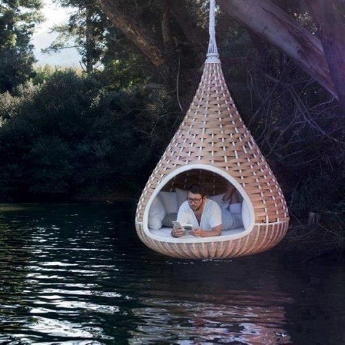 a hanging chair cocoon...amazing on so many levels (get it? get it?)