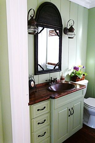 The perfect powder room for a joyful country cottage.