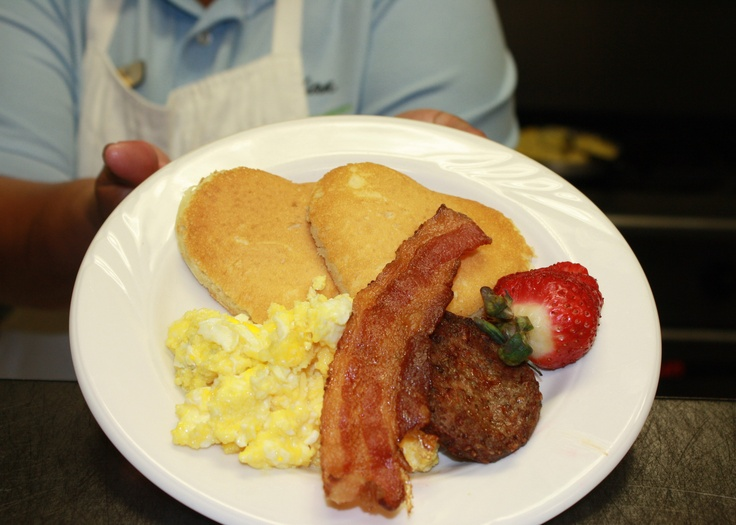 Ms. Ella creates a special breakfast for Valentine's Day!  Heart Shaped pancakes, bacon, sausage, & eggs, garnished with fresh Kentucky Proud strawberries.   Exellent Presentation