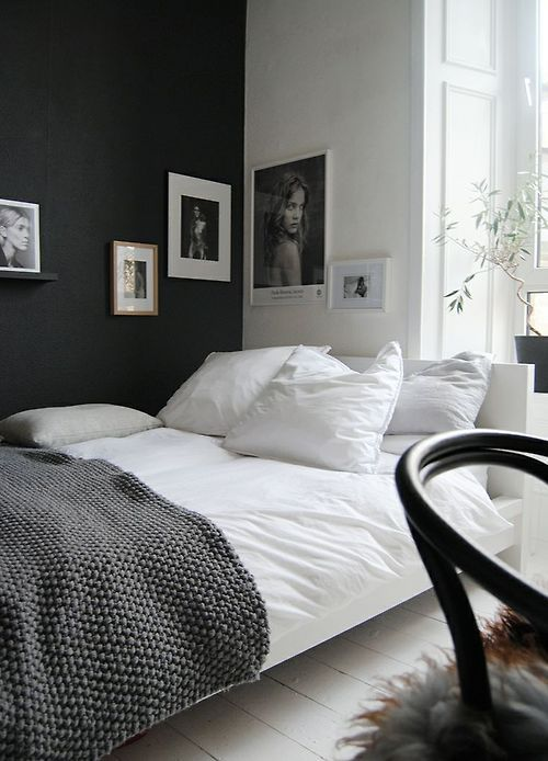 Simple bedding. Swap out the black throw for something with a bit of colour to give it warmth.
