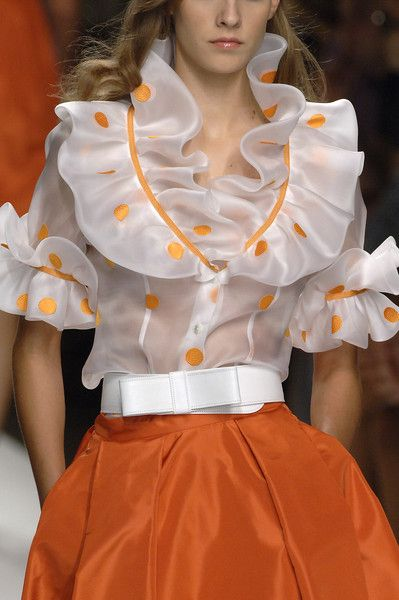 Two trends from two Elizabethan periods: ruffles from the 1600s, citrus red from 2013.