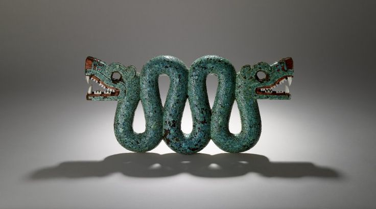 Pectoral, in the form of a double-headed serpent. Made of cedro wood (Cedrela odorata) and covered with mosaic made of turquoise and red thorny oyster shell (Spondylus princeps). The teeth in the two open mouths are made from conch shell (Strombus). Two resins are used as adhesive: pine resin and Bursera resin (copal). In the mouths the resin is coloured red with hematite. Beeswax adhesive survives around the eye sockets.