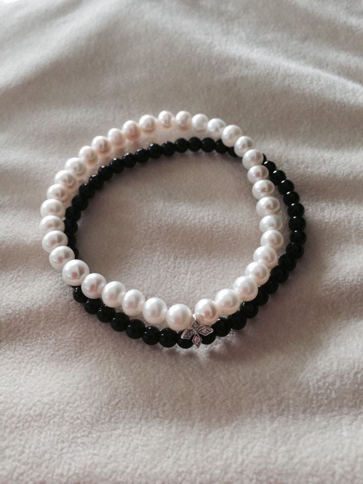 A personal favourite from my Etsy shop https://www.etsy.com/au/listing/245729412/white-pearl-onyx-charmed-double-row