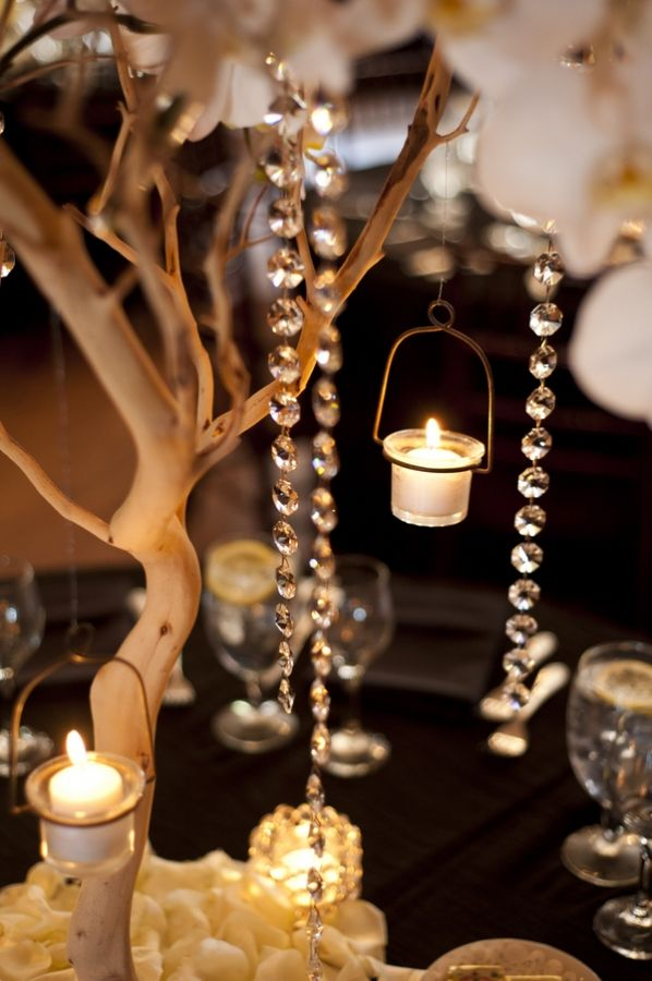 manzanita branches with hanging candles - wedding centerpieces