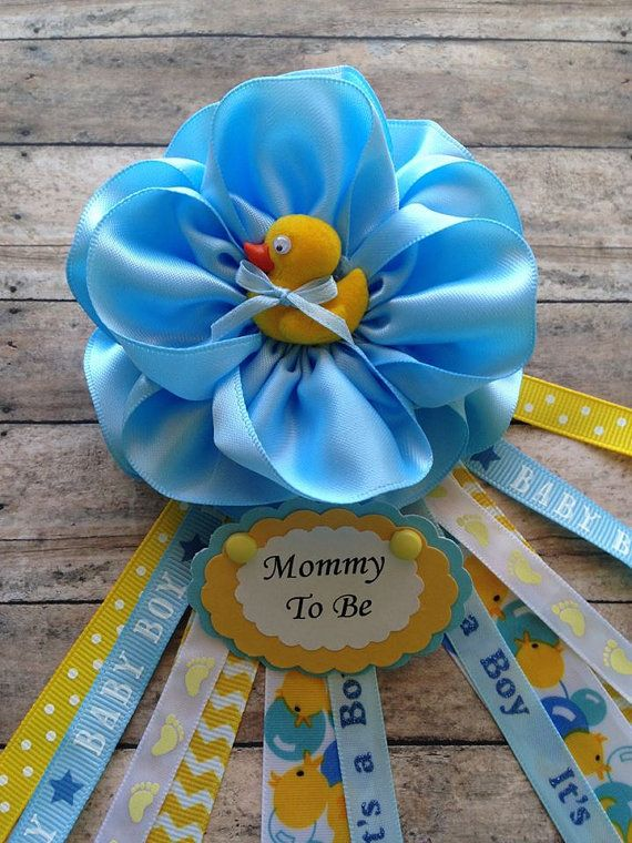 Ready for next day shipping Rubber Ducky Theme Mommy To Be Corsage Baby Shower Corsage *These listing is for 1 Mommy to be Corsage, rubber ducky theme. The corsage is handmade in a satin fabric flower. It is for Its a Boy baby shower, a rubber ducky embelishment adorns the