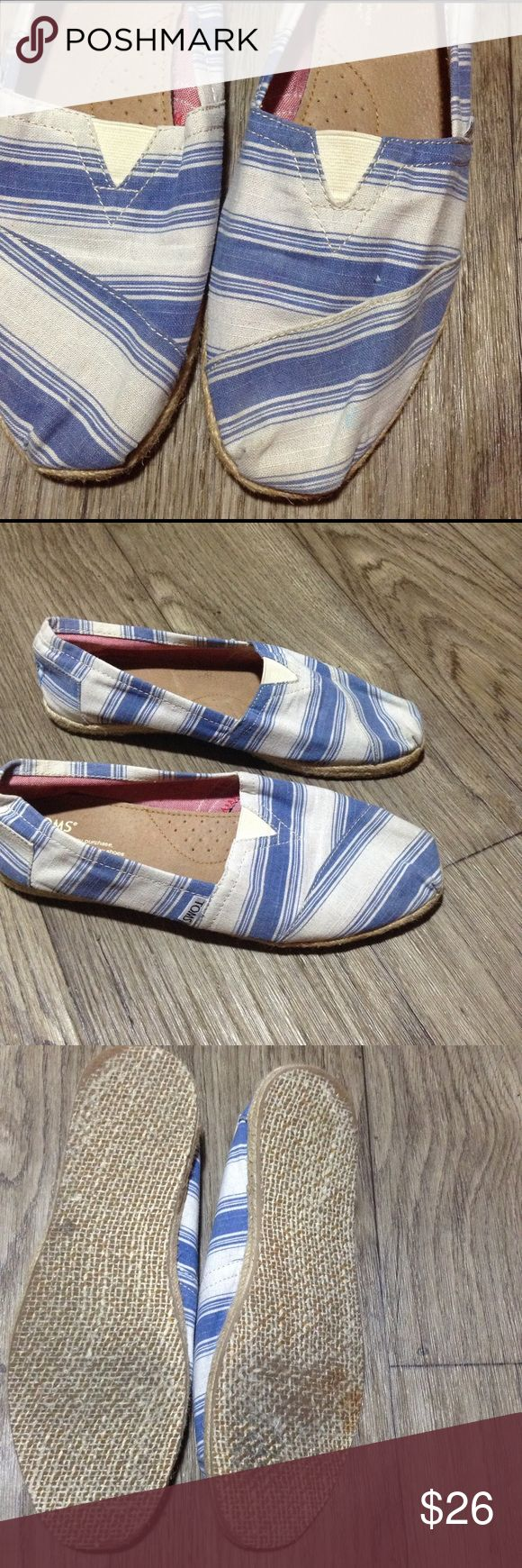 Toms blue/white striped print straw soles Sz 10 Toms blue/white stripes with straw soles size 10 women. Have a stain on front left shoe and some wear but still have lots of life. TOMS Shoes Espadrilles