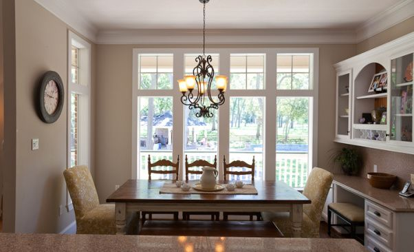 Southern charm kitchen, a southern charm kitchen, elegant country, a little french influence. Silestone counters - Kona Beige and Coffee Brown on the island, farmhouse table, and white cabinets , the breakfast room , Kitchens Design
