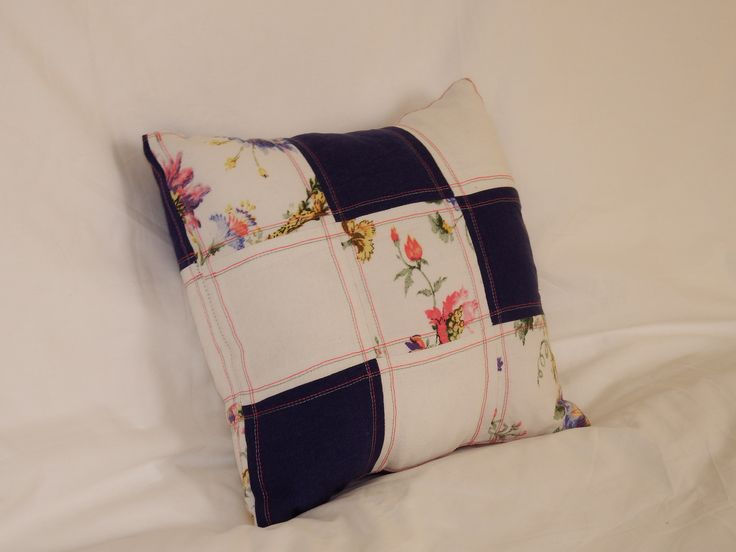 Patchwork throw pillow. Made out of old clothing.