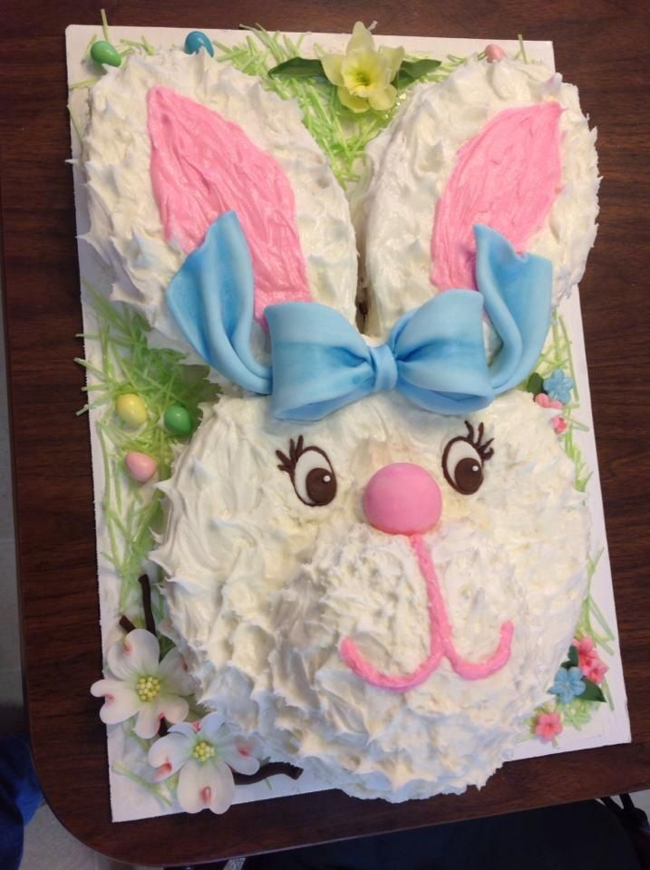 Easter Bunny Cake                                       All edible fondant decor: dogwood flowers, daffodils, edible grass with jelly beans and a large blue bunny bow. The kids loved him...