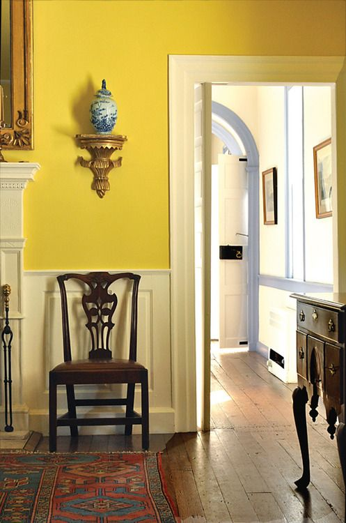 Old floors, yellow walls, blue and white porcelain, gold accents, antique furniture