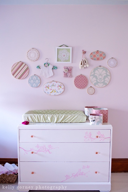 A Sweet Girl's Nursery love the thought of the embroidery hoops