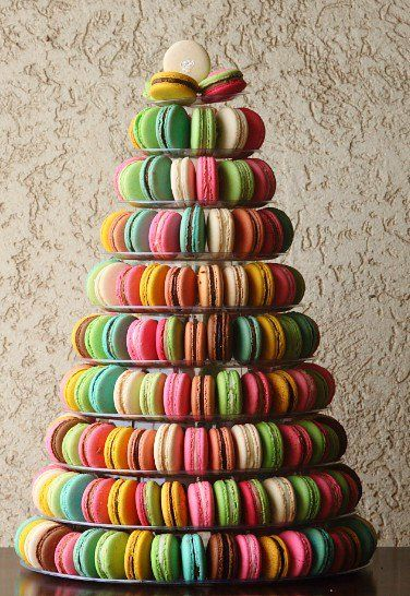 this rainbow macaroon tower is awesome...I will have a fancy party with a macaroon tower someday!!!