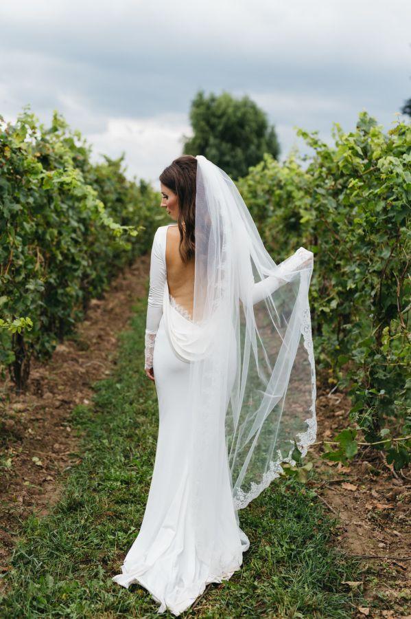 Gorgeous cowl back wedding dress: http://www.stylemepretty.com/canada-weddings/ontario/niagara-falls/2016/01/29/glamorous-classic-vineyard-wedding/ | Photography: Laura Rowe - http://www.laurarowe.ca/