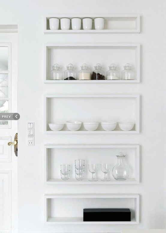Organizing the kitchen in all white -- what a brilliant way to take a kitchen from cluttered to clean.