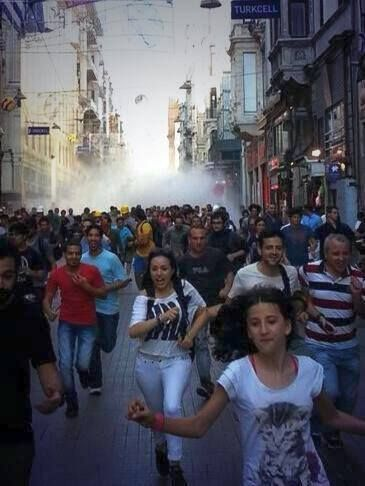 we are still smiling - Police continues to disperse the crowds on Istiklal Avenue with tear gas and water cannons. The protesters are regrouping in the side alleys and coming back.
