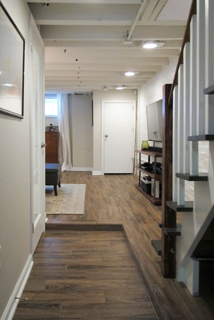 Cozy Chic Basement Reno With Exposed Painted Joists Wood Tile Floors Cheap Basement Remodel Basement Remodeling Basement Remodel Diy