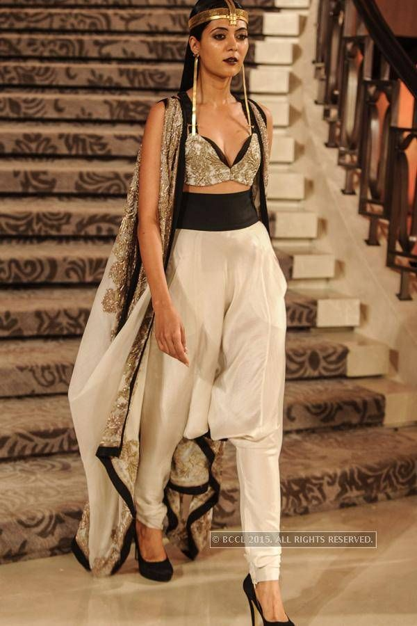 A model walks the ramp for Anamika Khanna during the grand finale of the Lakme Fashion Week (LFW) Summer Resort 2015, held in Mumbai.(BCCL/Prathamesh Bandekar)See more of: LFW '15: Grand Finale: Anamika Khanna