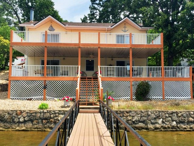 Nicely updated home on gentle lot in deep water cove. Large decks, low maintenance landscaping, vinyl siding, attached carport. Neighborhood of nice homes. Second tier lot is common ground, great place to park your boat trailer in Sunrise Beach MO