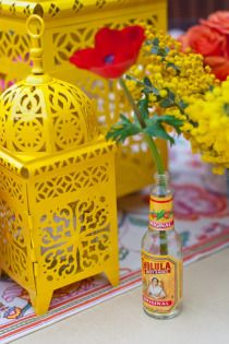 cholula bottles..super cute idea. Bright yellow Mexico! #Mexico #yellow #Mexican decorations