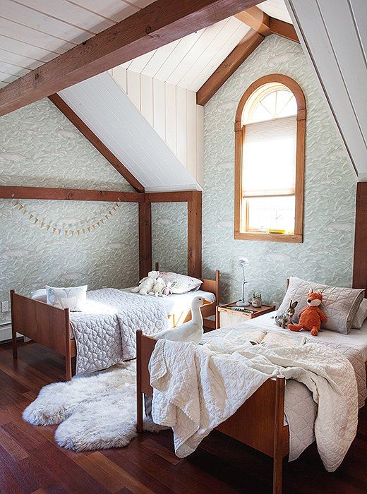 Subtly patterned wallpaper is an extra-sweet touch in this darling shabby chic-meets-midcentury styled kids' room.