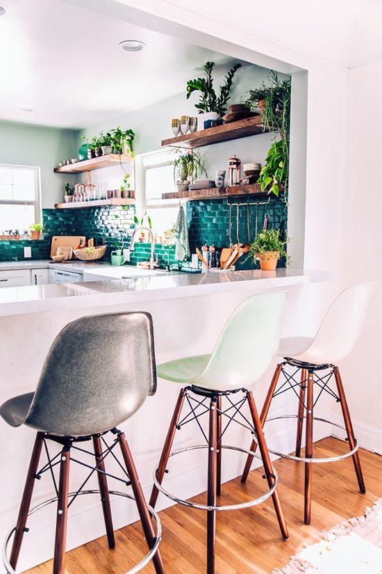 Mismatched modern barstools in Justine Blakeney's Jungalow kitchen