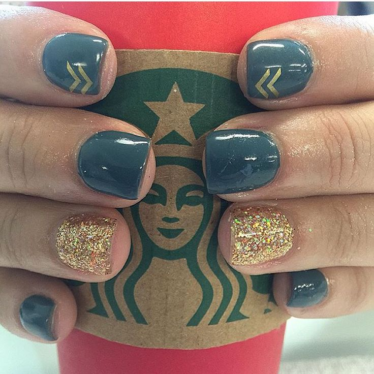 Nails.  Teal and gold with an arrow or two ... They look good on my Starbucks   Nails by Brandi
