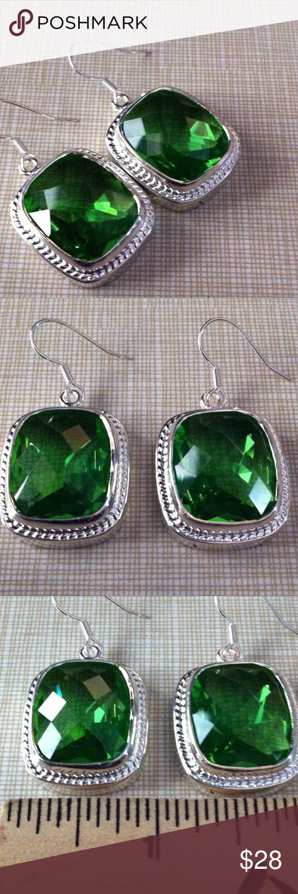 Gorgeous faceted green topaz earrings 20x17MM Beautiful piece of jewelry rhodium over silver to prevent tarnish handcrafted beautiful design faceted green topaz NWOT also stamped 925 approximately 1'3/4 long and over 1/2 ' wide Jewelry Earrings