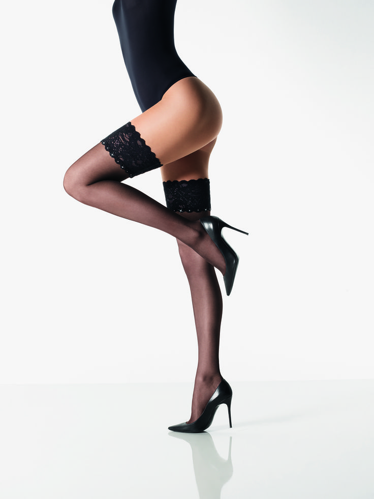 Silk Crystal Stay Up tights by Wolford feature Swarovski elements that embellish a floral lace band. Pure glamour.