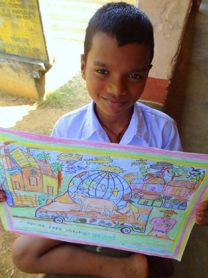 Sibananda Sethy, 11, from India proudly displays his award winning drawing