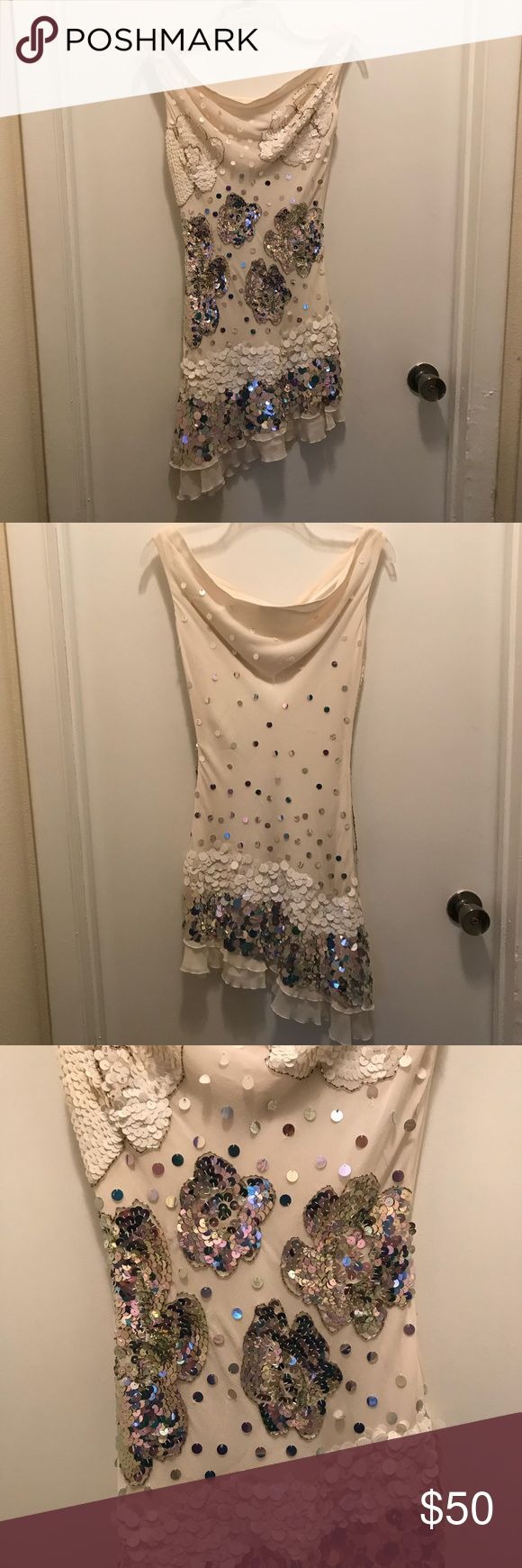 Marciano sequin dress Marciano sequin dress. Cream colored dress with silver and cream sequins. Asymmetrical hem. Excellent condition. Perfect for a night out Marciano Dresses Asymmetrical
