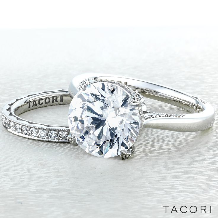 All eyes will be on your center diamond, in this not so simple solitaire round cut diamond engagement ring. A sleek band with secret diamond details along the inner face of the band brings your brilliant round cut diamond to life, making it worthy of your love. RoyalT HT2625RD10